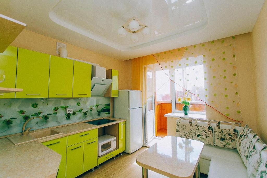 A kitchen or kitchenette at Апартаменты на Федерации 63-УИГА