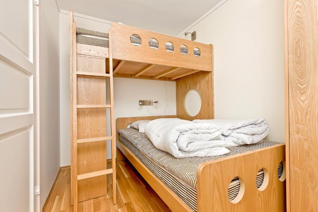 A bunk bed or bunk beds in a room at Pellestova Apartments