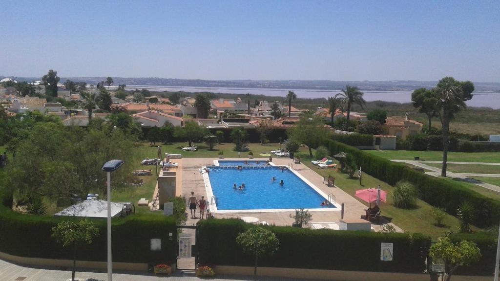 Vista de la piscina de Casa Frente Al Lago Rosa o alrededores