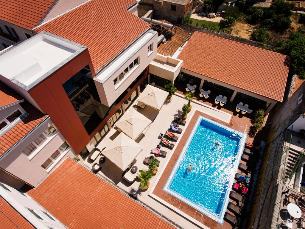 A view of the pool at Hotel Borovnik or nearby
