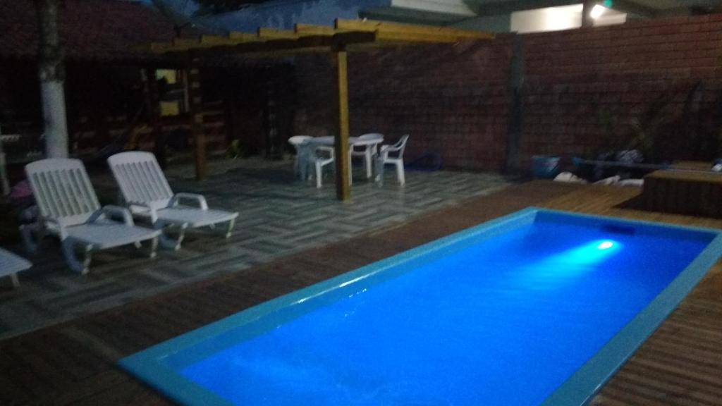 The swimming pool at or close to Casa em bombinhas - sc