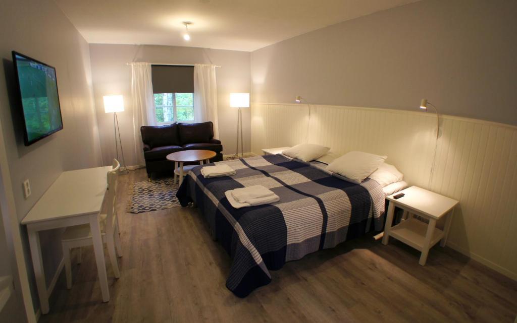 Säng eller sängar i ett rum på Mannflogården Bed & Breakfast