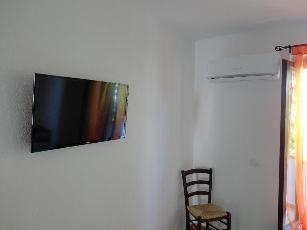TV o dispositivi per l'intrattenimento presso Bed and Breakfast Ichnos