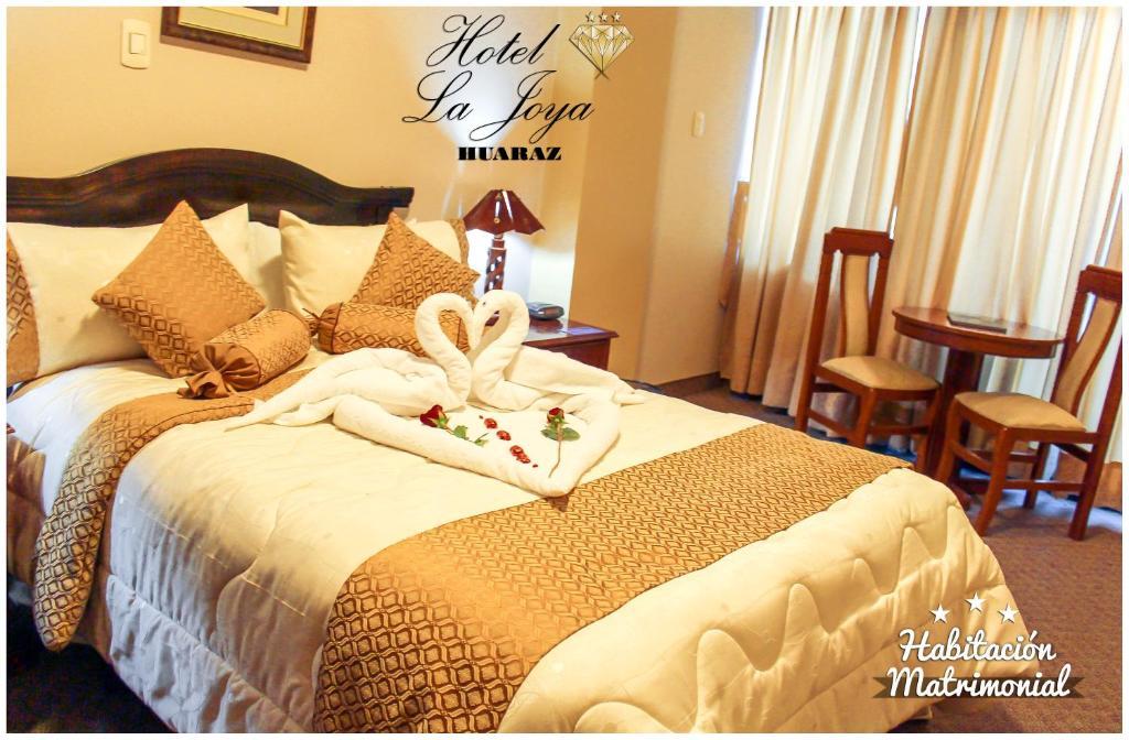 Cama o camas de una habitación en Hotel La Joya