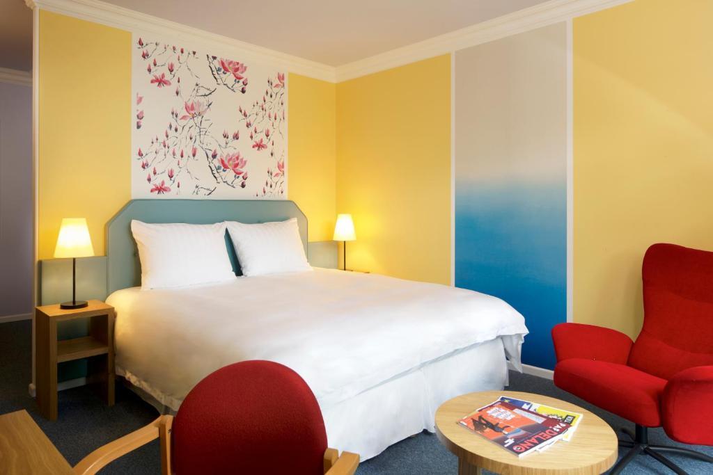Ein Bett oder Betten in einem Zimmer der Unterkunft Hotel Parc Plaza