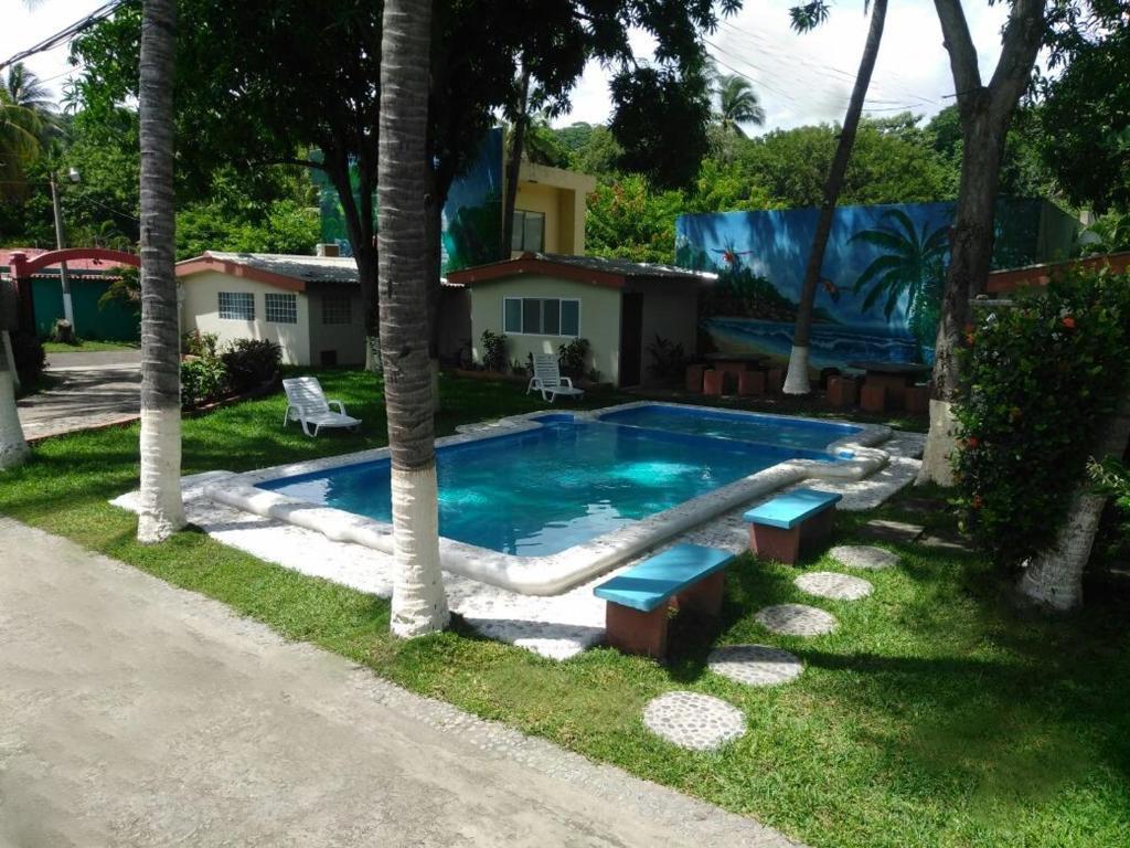 The swimming pool at or near Hotel y Restaurante Rincón Familiar