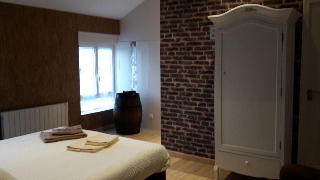 A bed or beds in a room at Chambre d'Hotes de la Loge