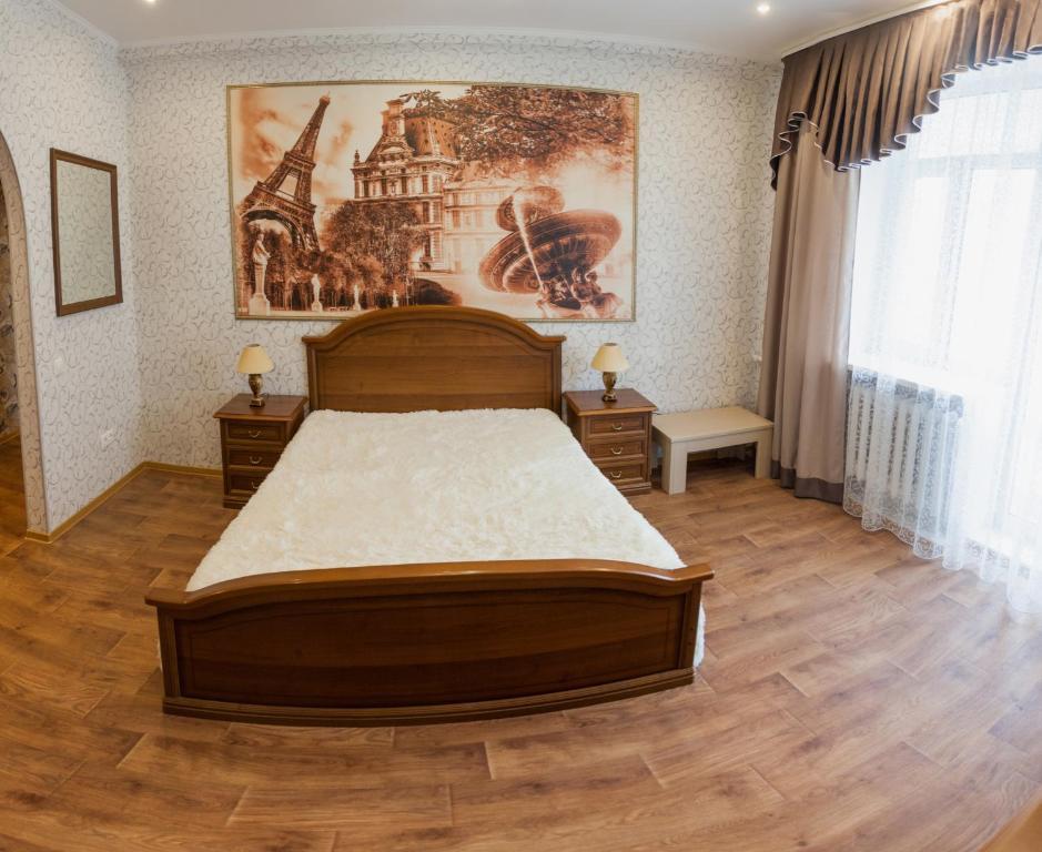 Кровать или кровати в номере Apartment on Lenina 69А