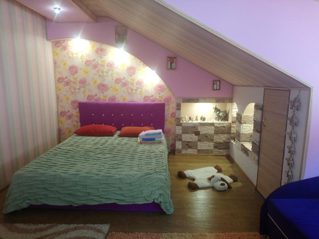Кровать или кровати в номере Дом для отдыха Анжела