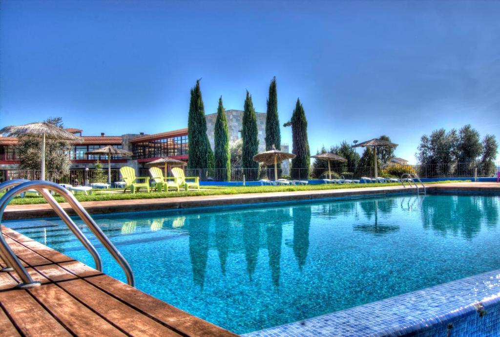 Piscina en o cerca de Villa Nazules Hípica Spa