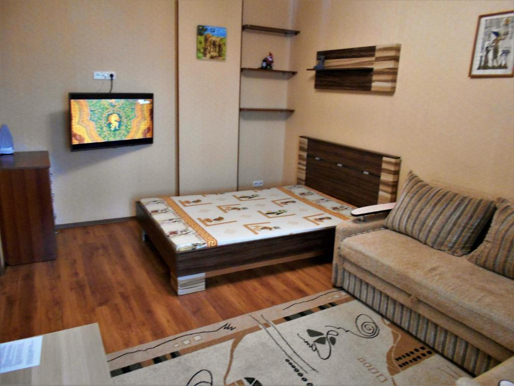 Кровать или кровати в номере 1 ком Малахова 119