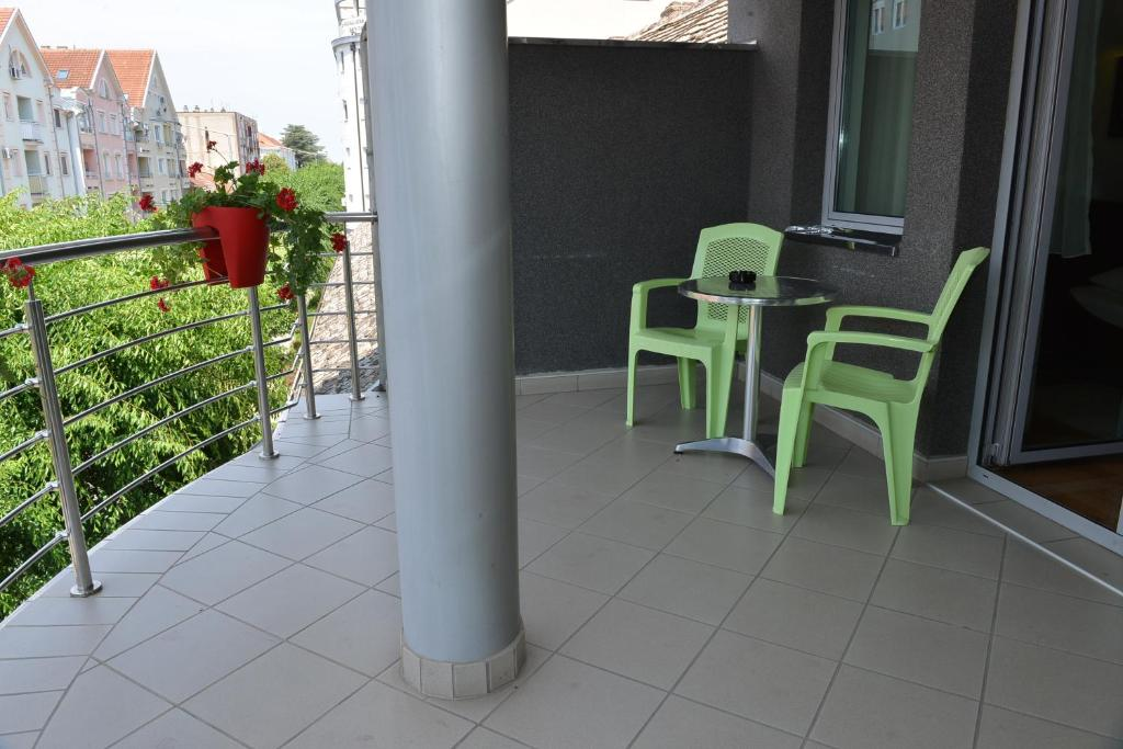 A balcony or terrace at Apartment and Rooms In Club