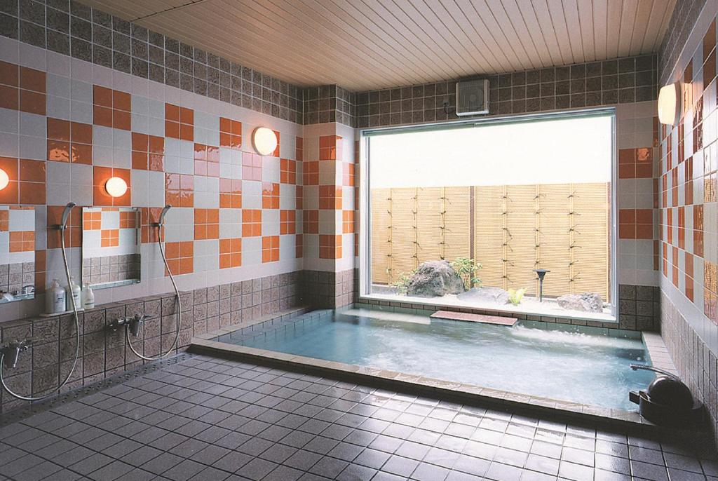 The swimming pool at or near Hotel Route-Inn Sapporo Shiroishi