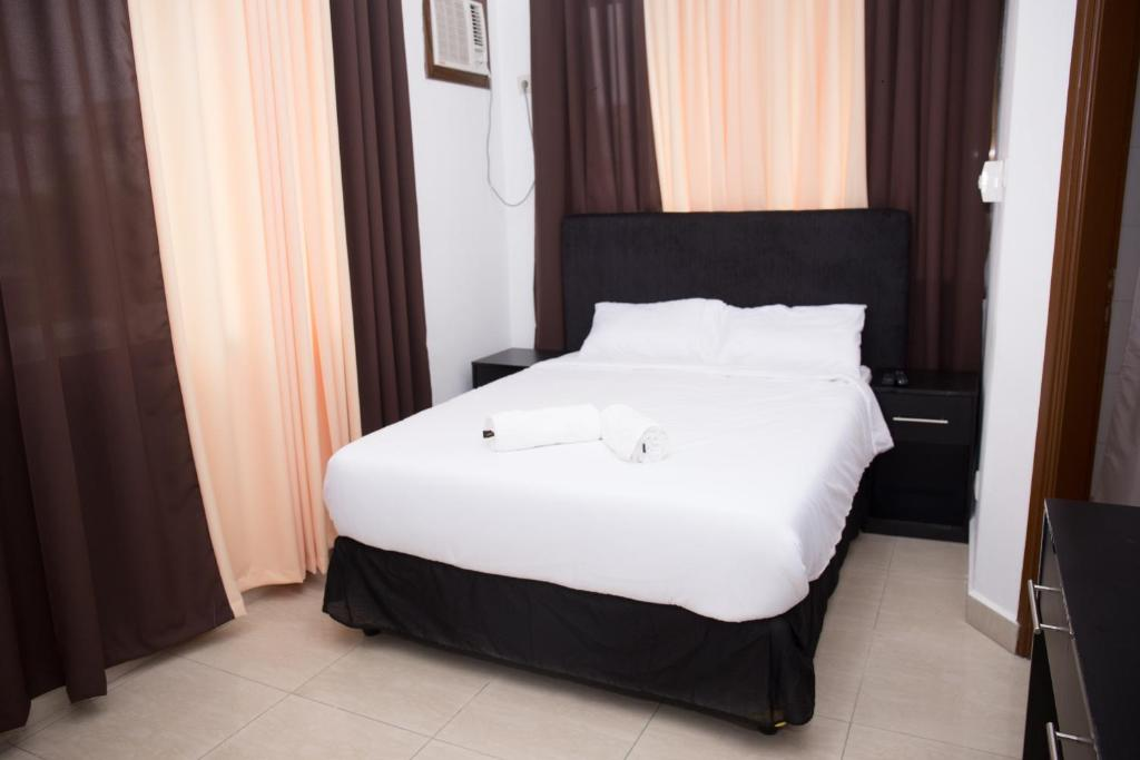 A bed or beds in a room at Residencial Horizonte