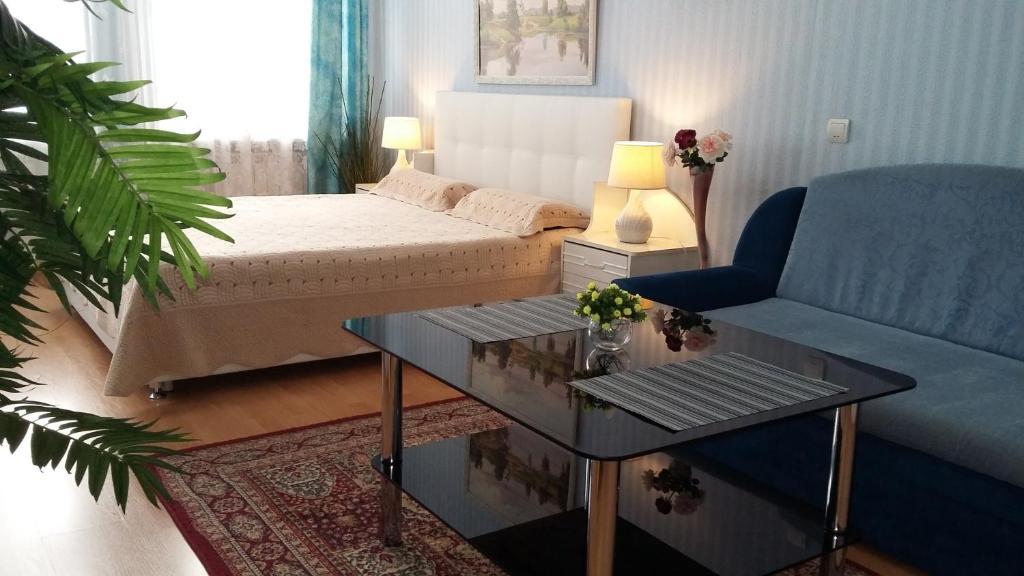 Кровать или кровати в номере Мини-отель Отрадный