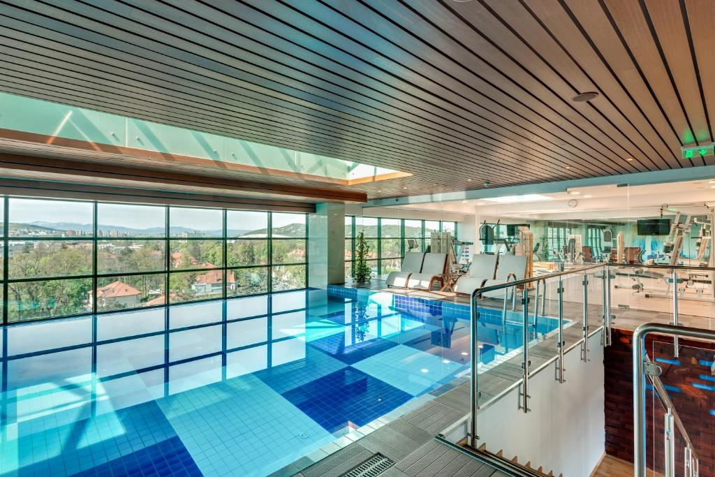 The swimming pool at or near DoubleTree by Hilton Hotel Cluj - City Plaza