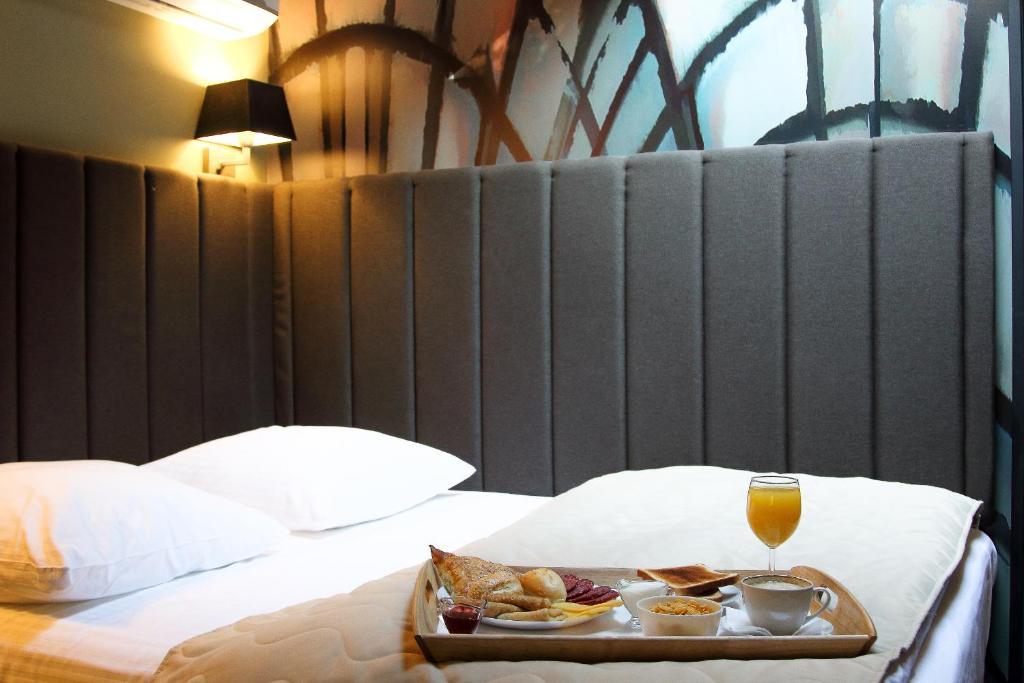 Кровать или кровати в номере Бутик-отель Веллион Бауманский