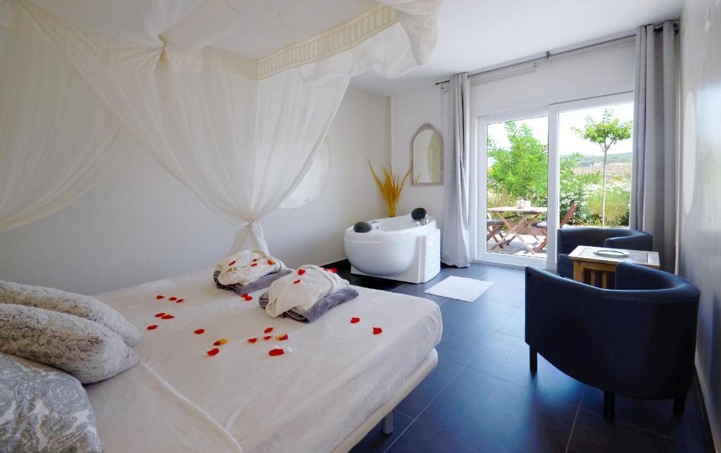 Cama o camas de una habitación en El Pao Spa