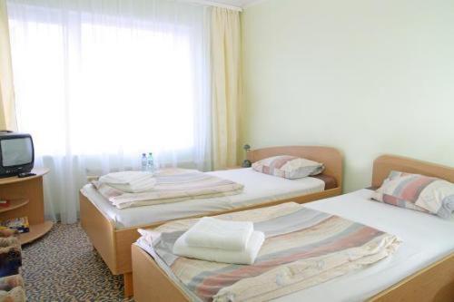 Gulta vai gultas numurā naktsmītnē Park Hotel Kekava