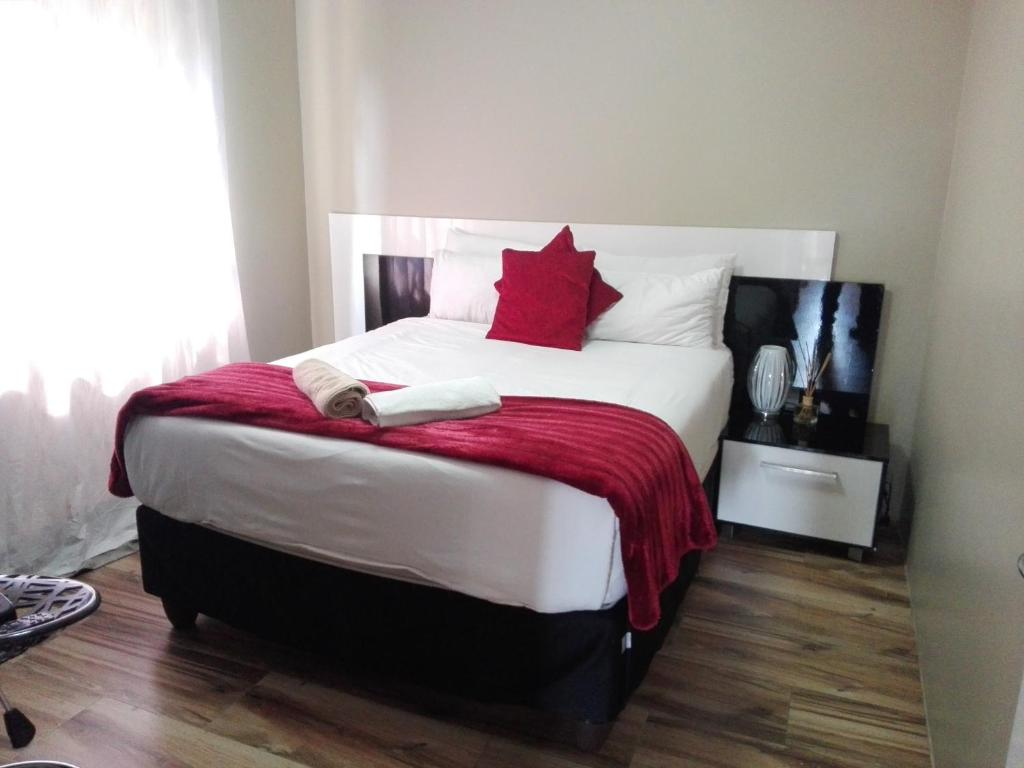 A bed or beds in a room at Angel Guest House