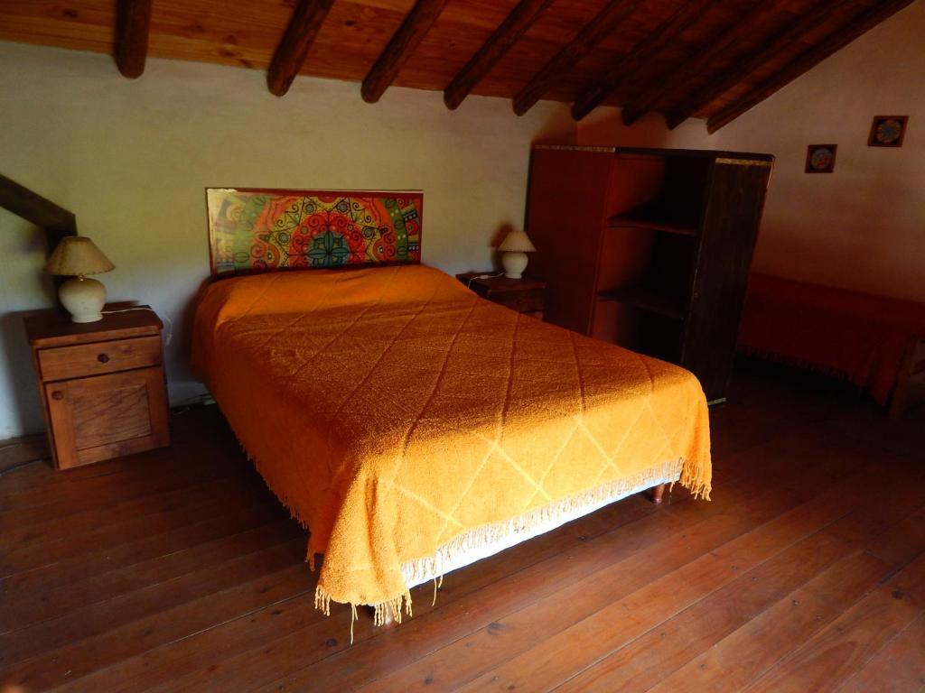 Una cama o camas en una habitación de Aire del Cerro