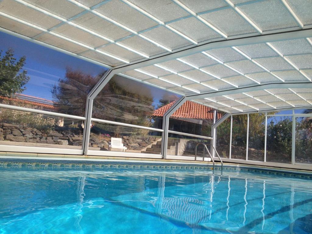The swimming pool at or near Casa Vale de Azibo