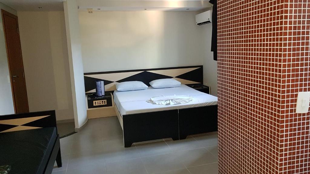 Cama ou camas em um quarto em Platinum Hotel