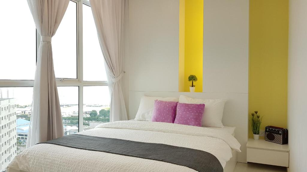 A bed or beds in a room at Penang Comfort Suite
