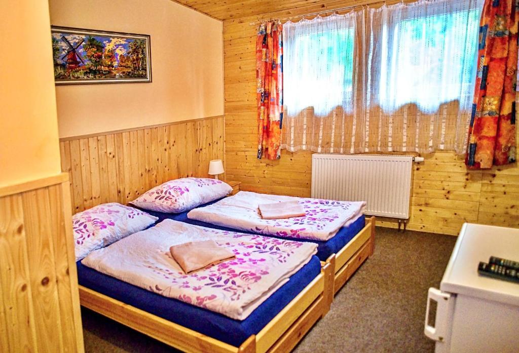 A bed or beds in a room at Penzion Radošov ubytování v soukromí