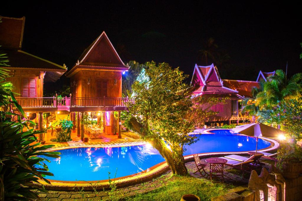 The swimming pool at or near Palm House Boutique Resort