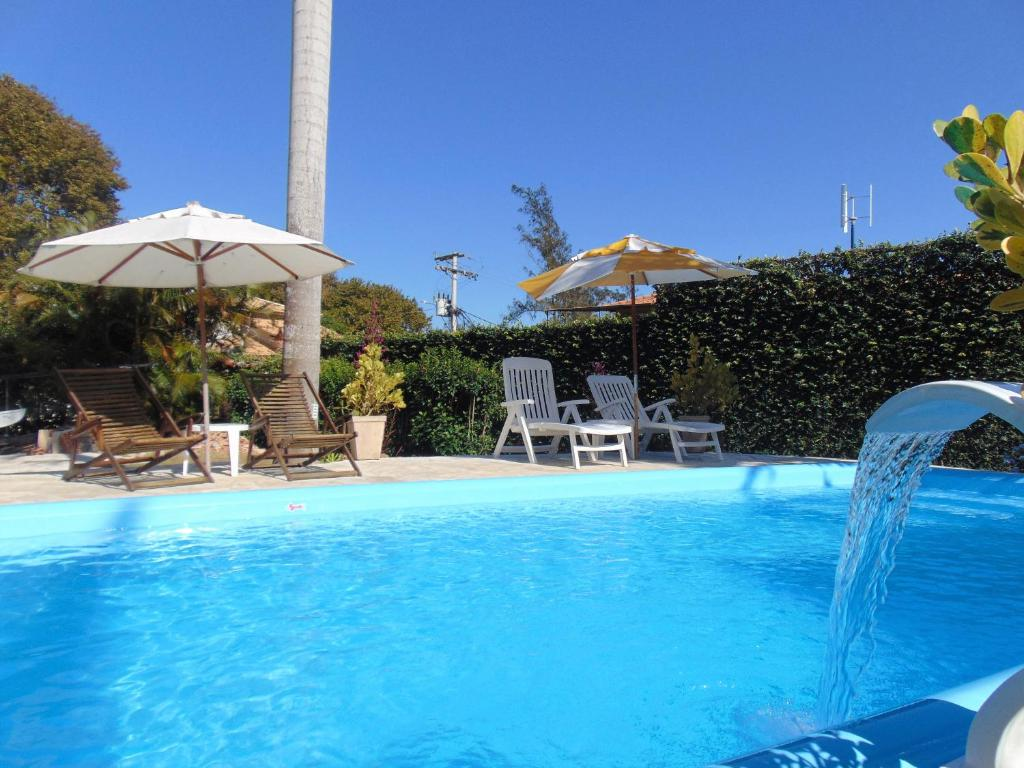 The swimming pool at or close to Apartamentos Portal da Ferradura
