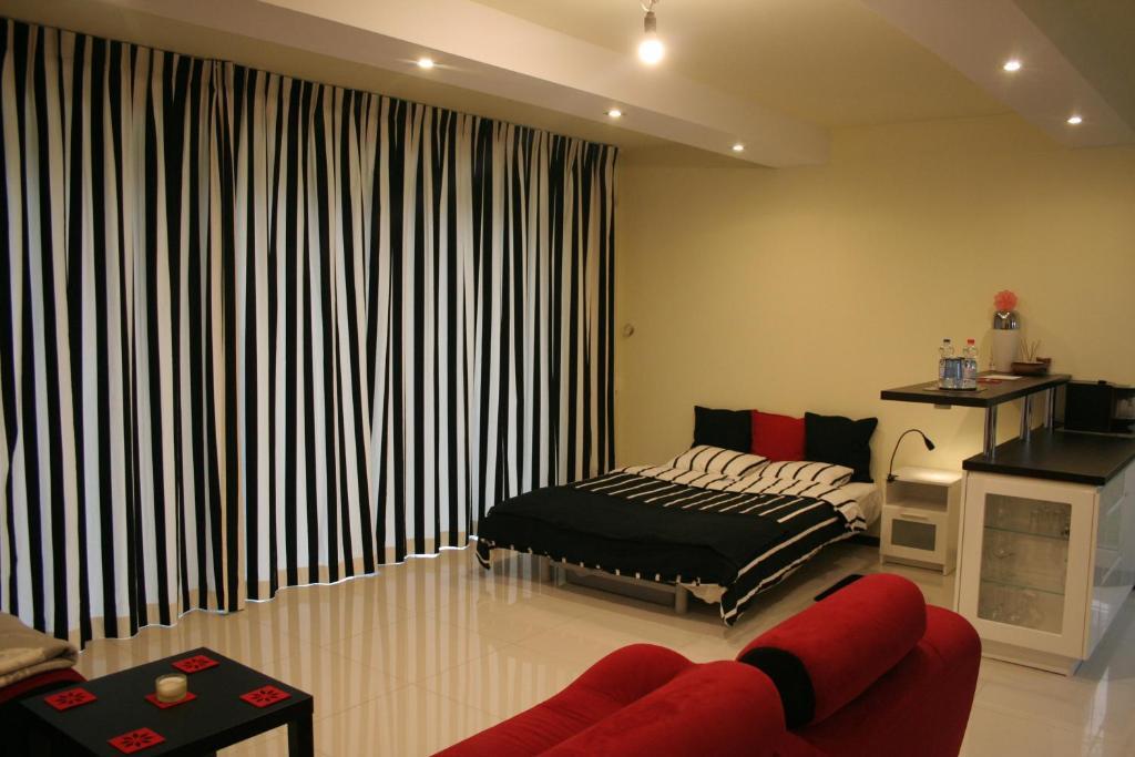 Łóżko lub łóżka w pokoju w obiekcie Casa Pablo