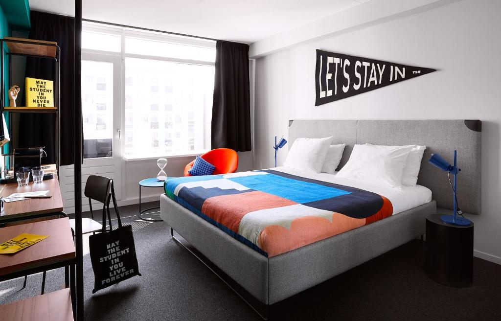 A bed or beds in a room at The Student Hotel The Hague