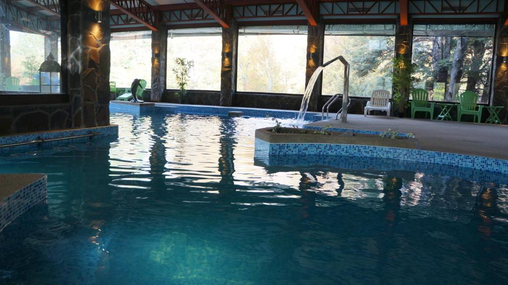 The swimming pool at or near Cabañas Blanche Neige Wellness & SPA