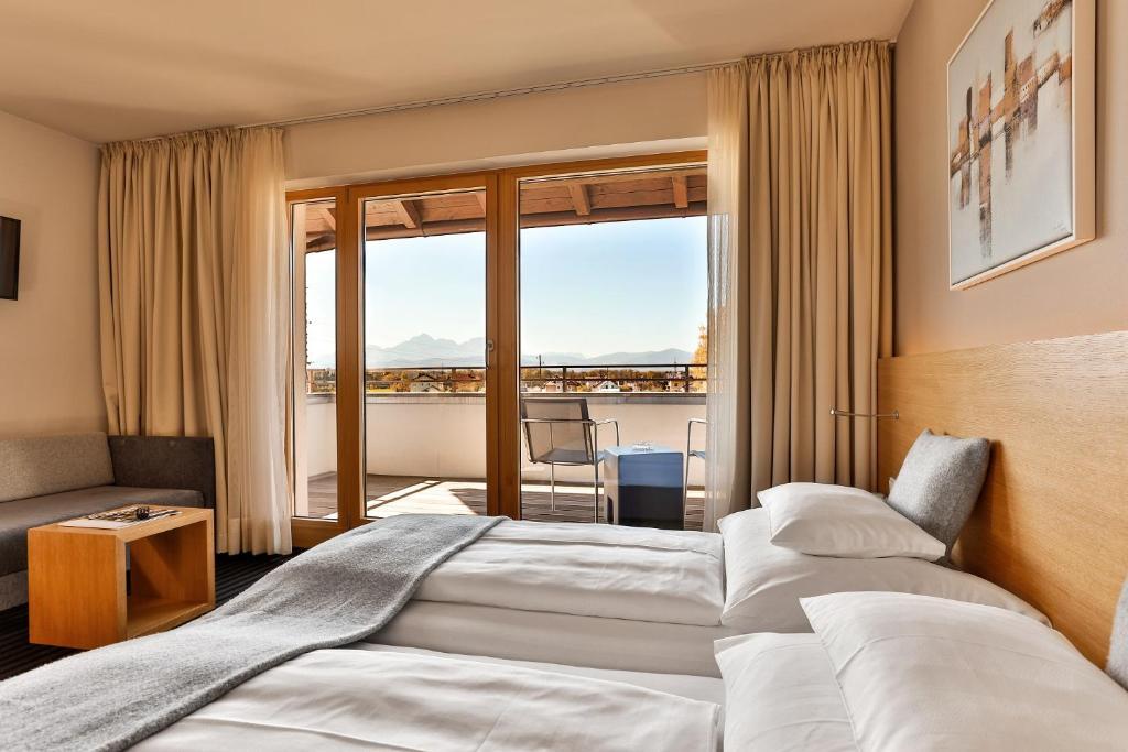 Ein Bett oder Betten in einem Zimmer der Unterkunft Hotel-Restaurant Ammerhauser