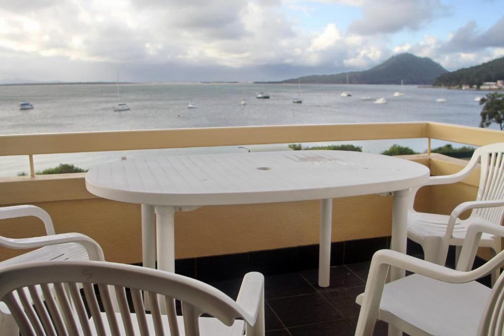 A balcony or terrace at Bay Village Unit 20, 47 Shoal Bay Road
