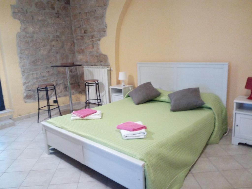 Letto o letti in una camera di Al Castello