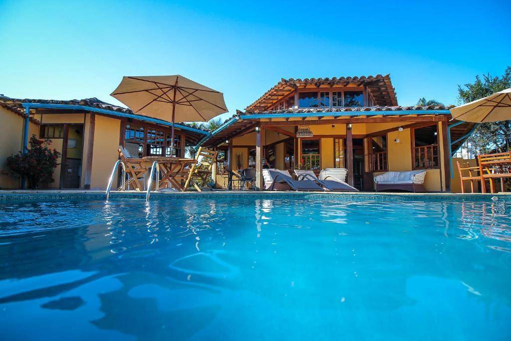 The swimming pool at or near Pousada das Pedras