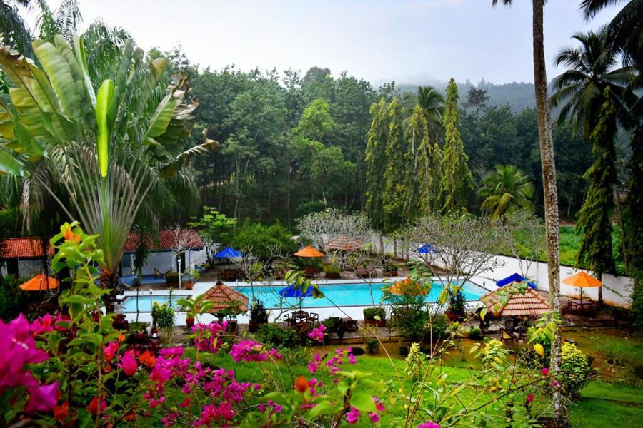 The swimming pool at or near Ratnaloka Tour Inns