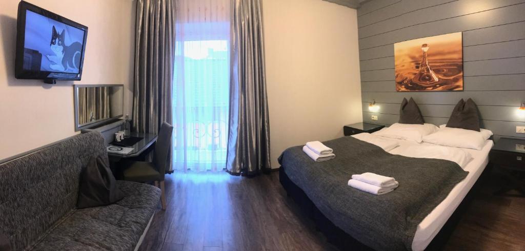 Ein Bett oder Betten in einem Zimmer der Unterkunft Hotel Vogelweiderhof