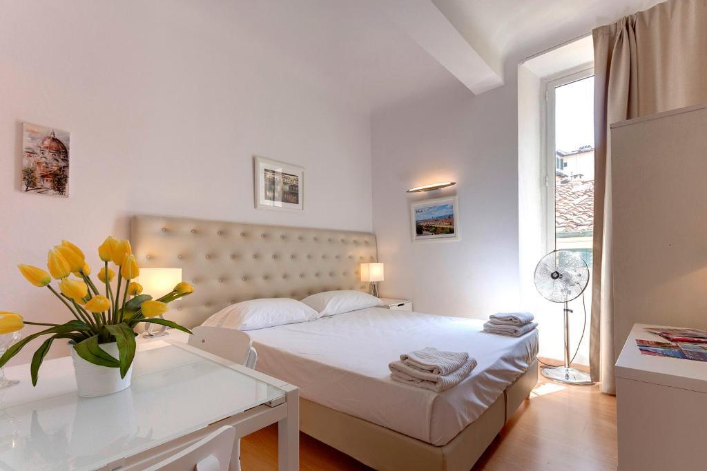 Cama o camas de una habitación en Residenza Castellani