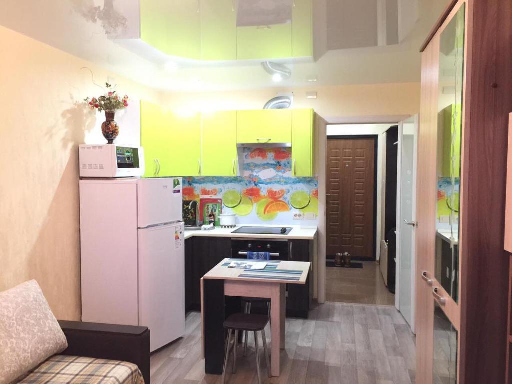 Кухня или мини-кухня в Апартамент