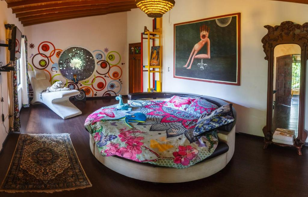 A bed or beds in a room at The Secret Buddha