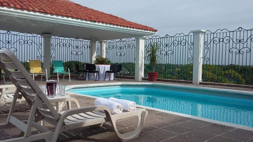 The swimming pool at or near Hotel & Suites Real del Lago