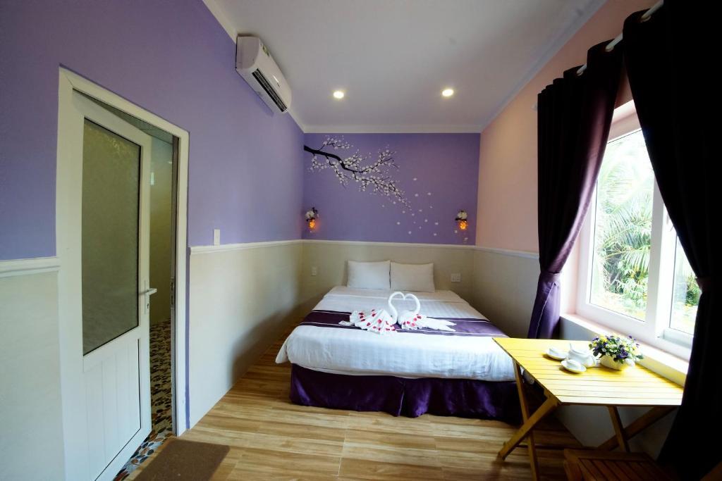 Giường trong phòng chung tại Q Songchi Hotel