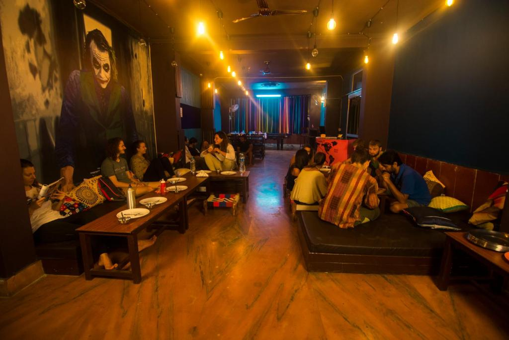 A restaurant or other place to eat at Live Free Hostel Rishikesh