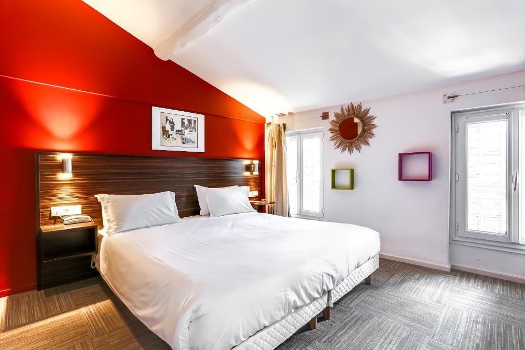 Un ou plusieurs lits dans un hébergement de l'établissement Hotel Le Mistral