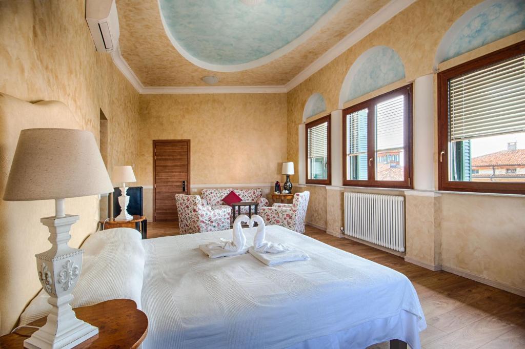 Letto o letti in una camera di Lady Verona Residence