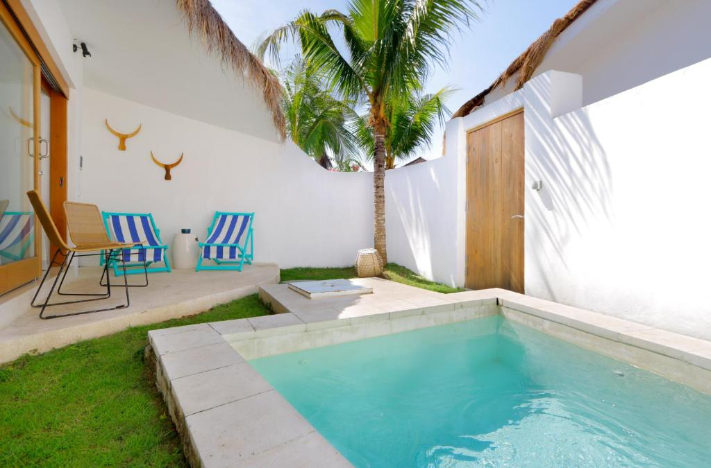 The swimming pool at or close to The Apartments Canggu