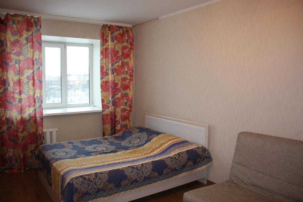 Кровать или кровати в номере 1-к квартира Покровский бульвар, 11